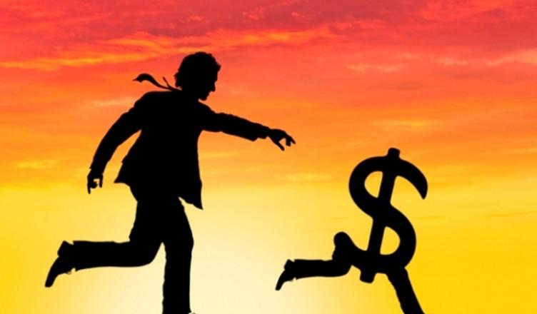 Dawn over man chasing money