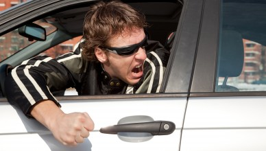 Aggressive driver concept young man driving aggressively