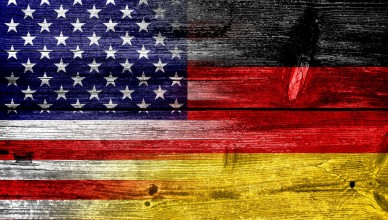 23424227 - usa and germany flag painted on old wood plank texture