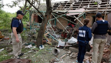 epa05963228 Observers of the Organization for Security and Co-operation in Europe (OSCE) inspect a private building, which was destroyed after a shelling of Avdiivka, Ukraine, 14 May 2017. Four civilian people were killed on the spot and another one was seriously injured after shelling of Avdiivka city on 13 May in the evening.  EPA/VALERI KVIT