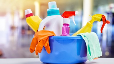 Basket with cleaning items on blurry background; Shutterstock ID 215591584; PO: today.com mish