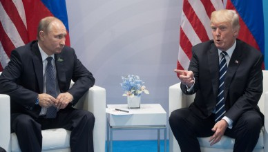 3148053 07/07/2017 July 7, 2017. Russian President Vladimir Putin and President of the USA Donald Trump, right, talk on the sidelines of the G20 summit in Hamburg. Sergey Guneev/Sputnik