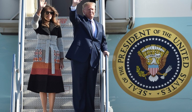 TOKYO, JAPAN - NOVEMBER 05 : U.S. President Donald Trump (R) and his wife Melania Trump (L) wave as they arrive at Yokota Air Base in Tokyo, Japan on November 5, 2017. Kazuhiro Nogi / Anadolu Agency