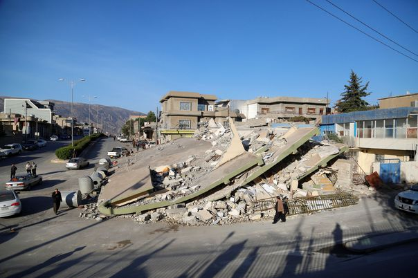 SULAYMANIYAH, IRAQ - NOVEMBER 13: Collapsed buildings are seen in Derbendihan district of Sulaymaniyah, Iraq on November 13, 2017 following a 7.3 magnitude earthquake that hit the Iraq and Iran. An earthquake measuring 7.3 on the Richter scale rocked northern Iraq and Iran, the U.S. Geological Survey said on Sunday evening. Turkish paramedic teams and rescue teams dispatched to the disaster area under the coordination of Turkish aid agencies; AFAD (Turkey's Disaster Management Agency) and Kizilay (Turkish Red Crescent). At least 211 died and 2,504 others were injured in Iran's bordering regions, especially in Kermanshah province in west. Yunus Keles / Anadolu Agency