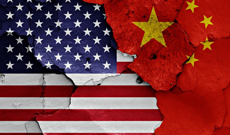 50105888 - flags of usa and china painted on cracked wall