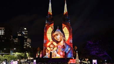 St Mary's Cathedral is illuminated with a Christmas-themed projection in Sydney to celebrate the Christmas season on December 9, 2016. / AFP PHOTO / SAEED KHAN