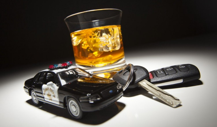 Highway Patrol Police Car Next to Alcoholic Drink and Key