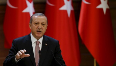 """Turkish President Tayyip Erdogan makes a speech during his meeting with mukhtars at the Presidential Palace in Ankara, Turkey, November 26, 2015. Erdogan on Thursday dismissed as """"emotional"""" and """"unfitting of politicians"""" suggestions that projects with Russia could be cancelled in the wake of Turkey's downing of a Russian warplane near the Syrian border. Erdogan said the Russian jet was shot down on Tuesday in an """"automatic reaction"""" in line with standing instructions given to the military. Turkey's military rules of engagement were a separate issue to disagreements with Russia over Syria policy, he said, and said that Ankara would continue to support moderate rebels in Syria and Turkmen fighters battling President Bashar al-Assad. REUTERS/Umit Bektas - RTX1VXSV"""