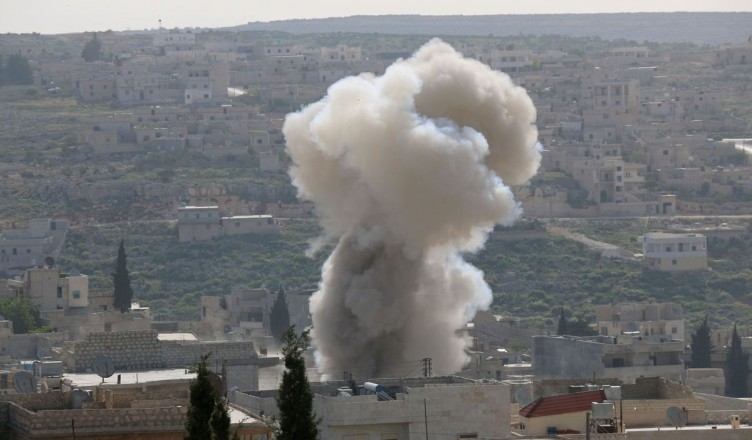 ALEPPO, SYRIA - APRIL 22: Smoke rises after the war crafts belong to Assad Regime forces carried out airstrikes on the Darat Izza district of Aleppo, Syria on April 22, 2017. Mahmud Faisal / Anadolu Agency