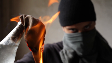 war-terror-man-mask-syria-warrior-taliban-afghanistan-fire-bomb_e1xi5j4zf__F0000