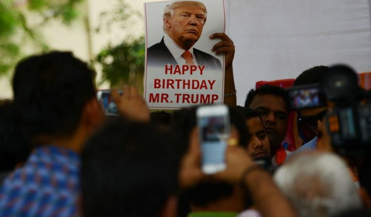 "Indian right-wing Hindu activists hold a celebration to mark the 70th birthday of US Republican presidential candidate Donald Trump in New Delhi on June 14, 2016. A far-right Hindu group has previously held prayers in the Indian capital to support the Republican presidential nominee, whose ideas and campaign promises they hail, and with  supporters saying he had the potential to ""save humanity"". / AFP / MONEY SHARMA        (Photo credit should read MONEY SHARMA/AFP/Getty Images)"