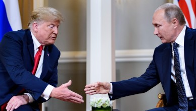 US President Donald Trump (L) and Russian President Vladimir Putin reach to shake hands before a meeting in Helsinki, on July 16, 2018. / AFP PHOTO / Brendan SmialowskiBRENDAN SMIALOWSKI/AFP/Getty Images ORIG FILE ID: AFP_17Q13H