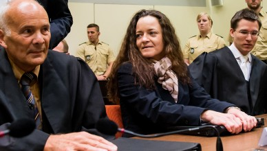 MUNICH, GERMANY - DECEMBER 9:  Beate Zschaepe, the main defendant in the NSU neo-Nazi murder trial, waits with her lawyers Mathias Grasel (R) and Hermann Borchert (L) for day 249 of the trial to start  at the Oberlandgericht courthouse on December 9, 2015 in Munich, Germany. Zschaepe is scheduled to finally testify today via her lawyer and hence break her silence that she has so far maintained throughout the trial. She and four others are accused of assisting neo-Nazis Uwe Boehnardt and Uwe Mundlos in a killing spree over an eight-year period of nine immigrants and one policewoman.  (Photo by Joerg Koch/Getty Images)