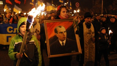 Kiev, Ukraine. 1st January 2014 -- Members of Svoboda (Freedom) Party are carrying the portrait of Stepan Bandera during the torchlights processions in Kiev. -- Torchlights processions to honor Ukrainian nationalist leader Stepan Bandera 105th anniversary took place in Kiev. Bandera was one of the leaders of Ukrainian national movement who headed the Organization of Ukrainian Nationalists (OUN).