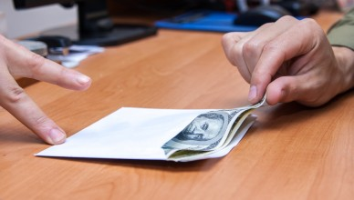 The transfer of an envelope with a bribe