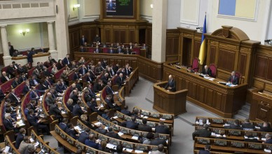 Ukrainian Prime Minister Arseny Yatseniuk addresses parliament in Kiev March 11, 2014. Ukraine's parliament on Tuesday warned the regional assembly in Crimea, which is now controlled by pro-Russia forces, that it faces dissolution unless it cancels a referendum it has called to join the region to Russia.  REUTERS/Alex Kuzmin  (UKRAINE - Tags: POLITICS CIVIL UNREST)