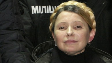 Ukrainian opposition leader Yulia Tymoshenko reacts after she was freed in Kharkiv February 22, 2014. Tymoshenko was freed on Saturday from the hospital where she had been held under prison guard for most of the time since she was convicted in 2011. The former prime minister, a bitter rival of President Viktor Yanukovich, waved to supporters from a car as she was driven out of the hospital in the northeastern city if Kharkiv, a Reuters photographer said. Tymoshenko, 53, was jailed in 2011 for abuse of office over a gas deal with Russia but her supporters and Western leaders say her trial was politically motivated.                REUTERS/Inna Petrykova  (UKRAINE  - Tags: POLITICS CIVIL UNREST TPX IMAGES OF THE DAY)