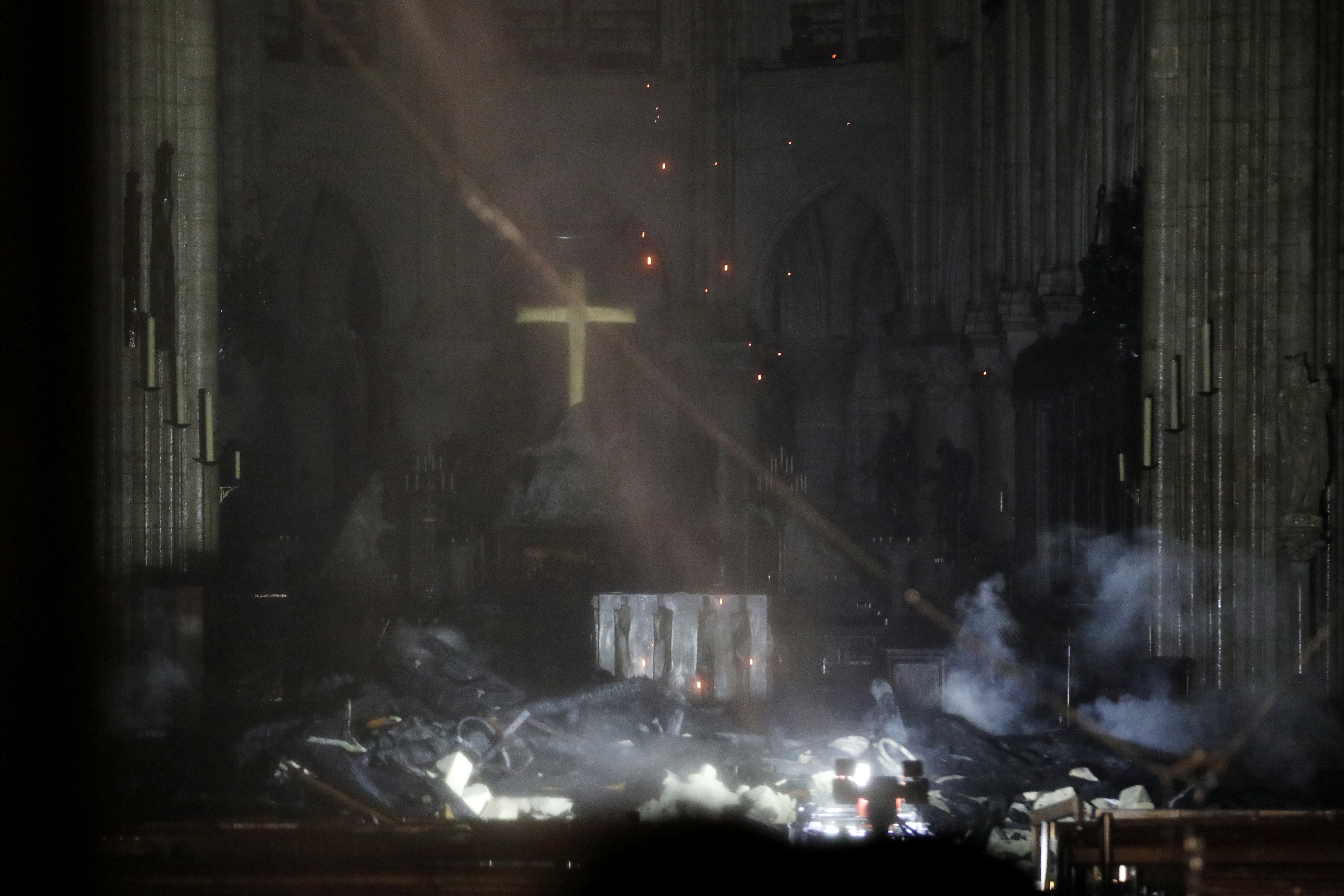 epa07509133 General view of the interior of the Notre-Dame Cathedral as flames are burning the roof cathedral in Paris, France, late 15 April 2019. A fire started in the late afternoon in one of the most visited monuments of the French capital.  EPA-EFE/YOAN VALAT