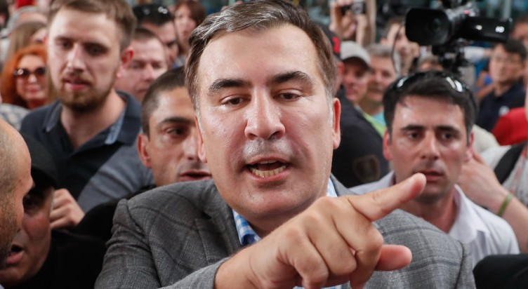 epa07610779 Mikheil Saakashvili (C) reacts as he arrives to the Kiev's airport Boryspil, Ukraine, 29 May 2019. The ex-president of Georgia and ex-Governor of Ukrainian Odesa region Mikheil Saakashvili returned to Ukraine after Ukrainian President Volodymyr Zelensky has reinstated Saakashvili?s Ukrainian citizenship. Zelensky deleted the respective provision from his predecessor Petro Poroshenko`s order dated 26 July 2017. Poroshenko late in July 2017 signed an order to strip Saakashvili of Ukrainian citizenship related to the fact that Saakashvili had provided wrong information when applying for Ukrainian citizenship, in particular, he did not mention his criminal record in Georgia as local media report.  EPA-EFE/SERGEY DOLZHENKO
