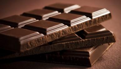 Chocolate bar on dark brown background