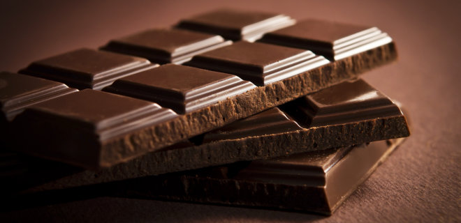 Chocolate bar on dark brown background