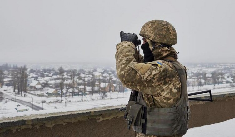 AVDIIVKA, UKRAINE - JANUARY 8: A Ukrainian serviceman eyes the frontline atop a building in the frontline city of Avdiivka as Ukrainian forces pushed back an attack by pro-Russian rebels on January 8, 2016 in Avdiivka, Ukraine. German Chancellor Angela Merkel has said she believes there could be progress in negotiations on the Ukraine crisis over the next few months as the Normandy negotiations take place between France, Germany, Russia and Ukraine. (Photo by Pierre Crom/Getty Images)