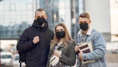 people-in-a-masks-stands-on-the-street_1157-31590
