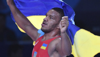 Zhan Beleniuk of Ukraine celebrates his victory over Viktor Lorincz of Hungary in the gold medal match of the men's Greco-Roman 87kg category of the Wrestling World Championships in Nur-Sultan, Kazakhstan, Monday, Sept. 16, 2019. (AP Photo/Anvar Ilyasov)