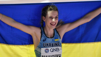 Yaroslava Mahuchikh, of Ukraine, celebrates after winning the silver medal in the women's high jump final during the World Athletics Championships in Doha, Qatar, Monday, Sept. 30, 2019. (AP Photo/Martin Meissner)